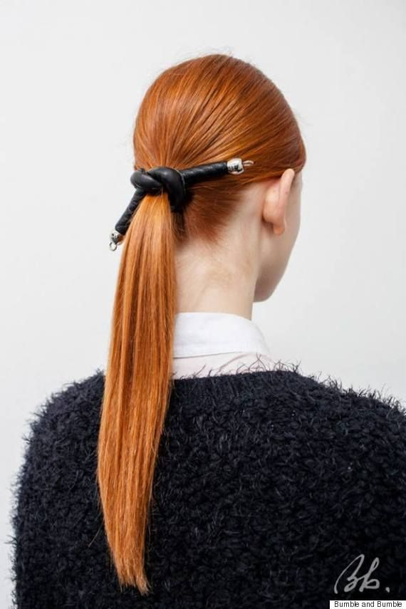 Tanya Taylor Fall 2015 -- Get the look: Mist Thickening Hairspray all over hair and blow dry. Then part hair down the center, make a ponytail and secure with an elastic band at the nape of the neck. Finish by wrapping a leather tie around the band spritz hair with Does It All to smooth any flyaways.