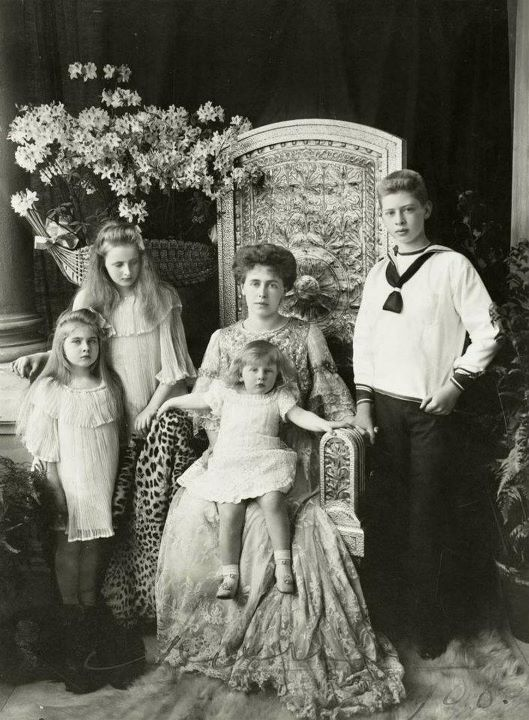 Crown Princess (later Queen) Marie of Romania and her 4 eldest children. From left, Princess Marie (later Queen of Yugoslavia), Princess Elisabeth (later Queen of Greece), Prince Nicholas, and Prince Carol (later King Carol II). Princess Marie's father was widely believed to be Barbu Stirbey, her mother's long time lover. To quiet the rumors Crown Prince Ferdinand quickly claimed Marie as his own.