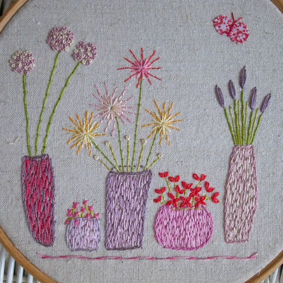 this pdf hand embroidery pattern comes with a colour guide and stitch guide with colour photographs for the design above. The flowers fit into a six inch hoop but you could always enlarge the pattern for a bigger hoop. There are also some extra flowers along with a butterfly and a dragonfly. If you dont want to frame your flowers in a hoop they would look rather nice in a patchwork quilt or cushion or even on a bag. You dont have to stitch all the flowers together, you can stitch them…