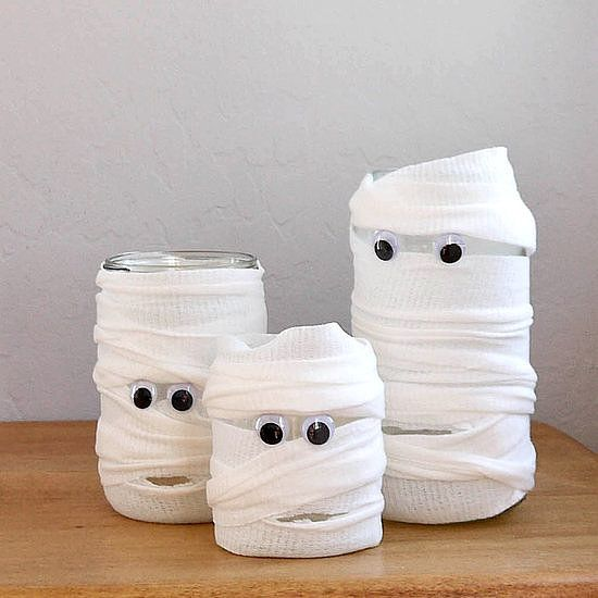 No need to be crafty for this Halloween project! All you need are a few glass containers, googly eyes, and a bit of gauze to create mummy jars for holding candy or candles or for being centerpieces.  Photo: Sarah Lipoff