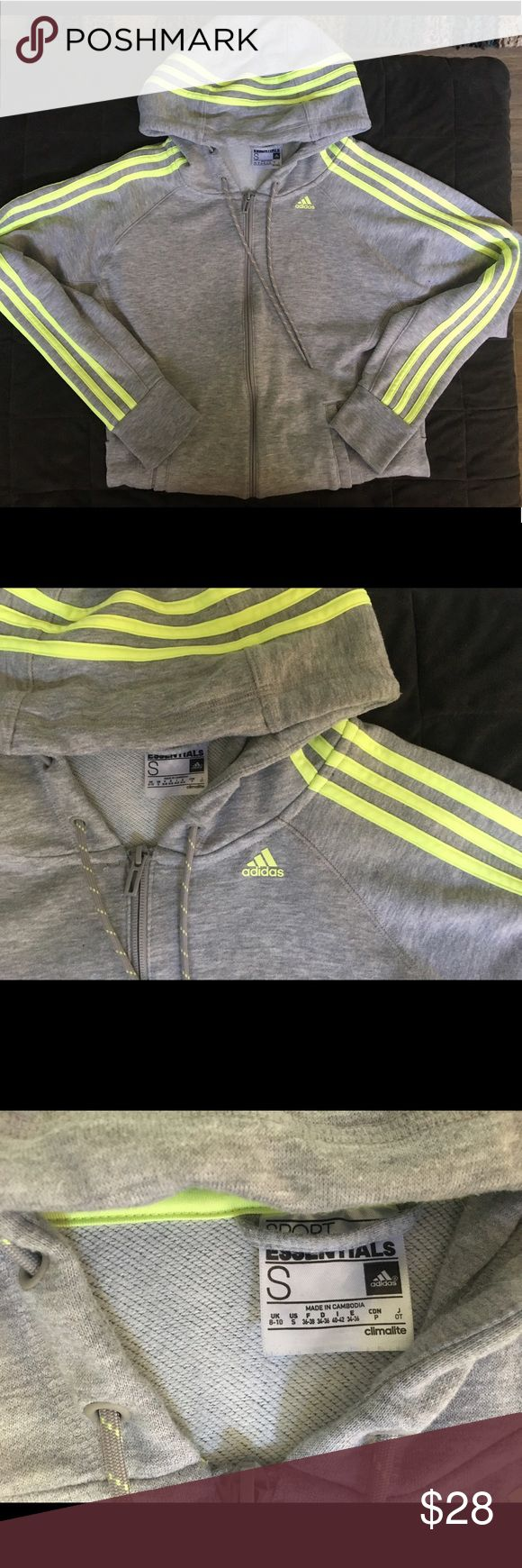 Adidas Neon Zip Up 3 stripe cotton zip up by Adidas. Purchased from official Adidas store. Worn handful of times, in GREAT condition. Minimal pilling that is not noticeable at all. Grey with neon yellow stripes going from hood to arms. Women's small, fits big so fits a medium as well. Adidas Sweaters