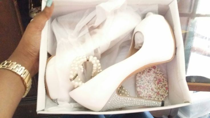 All white peep toe pump with silver accent heel