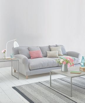Loaf's comfy grey Crumpet sofa with big feather-filled cushions and colourful scatter cushions in this relaxed living room
