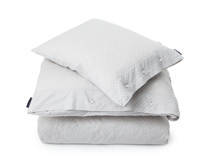 Jacquard bedding in gray and white with a soft and silky feel. Lexington classic closure with rubber buttons. Duvet and pillow case are sold separately.  100% Cotton Jacquard