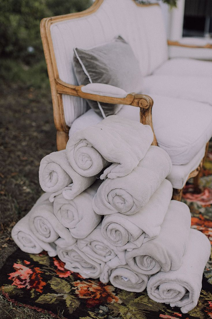 Wedding Ideas: Give your guests some cozy blankets to keep them warm during your outdoor reception.