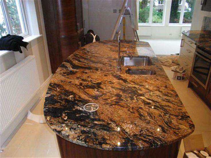 Magma gold granite countertop photos stone granite for Black and gold kitchen