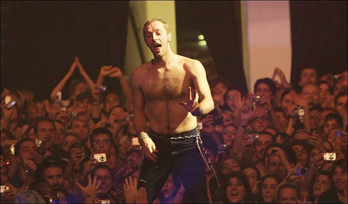 WOAH SHIRTLESS AT A CONCERT. He said it was just too hot!