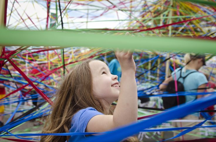 """Elastic ribbons around poles in the interactive art installment """"Tangle"""""""