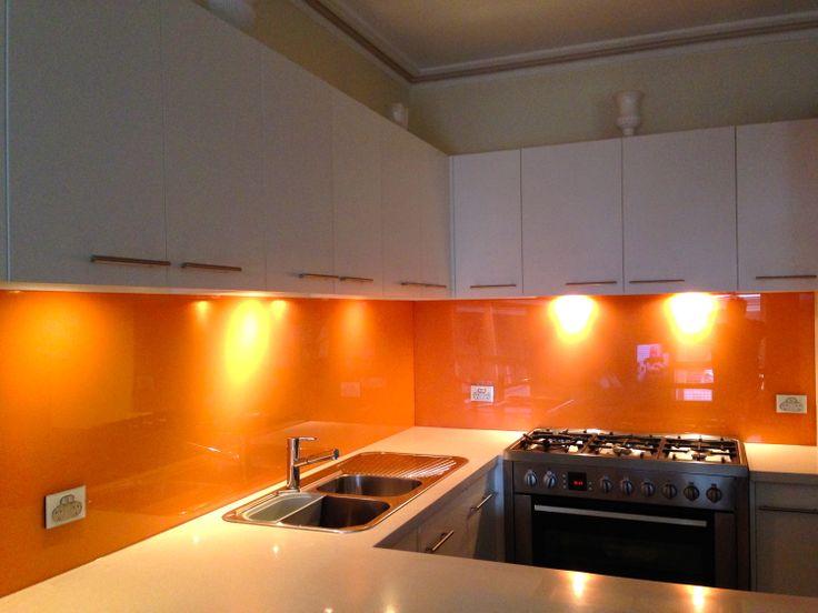 Orange coloured glass splashbacks are a popular choice!
