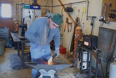 Shaping said chisel.  Tool steel=sore forearm.