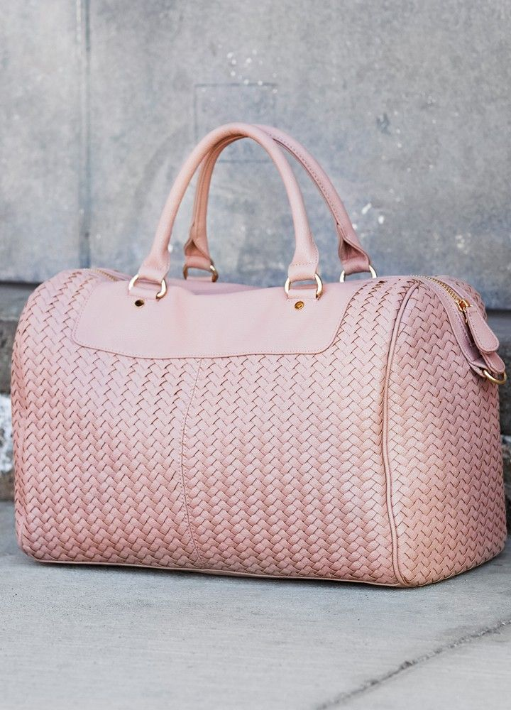 A large weekender bag with a woven design and crafted from buttery vegan leather. Includes top handles and a removable cross body strap.