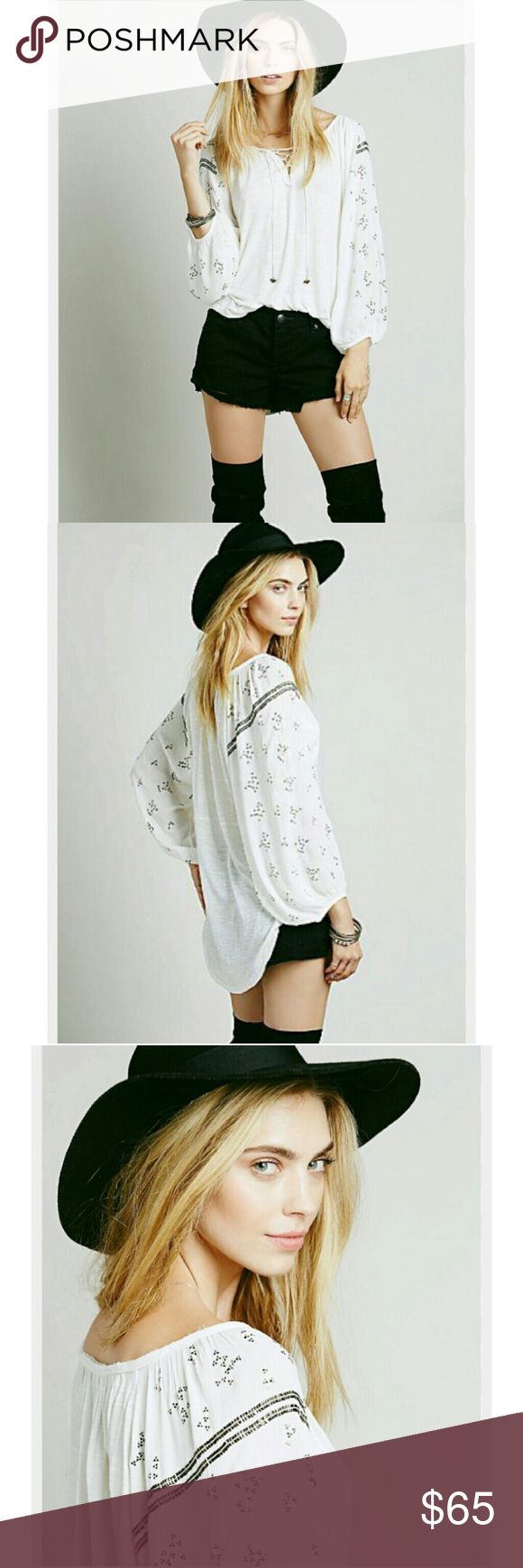 Free People Golden Nugget Peasant Top Free People Golden Nugget Peasant Top  Ivory color with silver triangle and rectangle beading embellished on shoulders. Lace-Up drawstring front neckline, Drawstrings feature wire wrapped bottoms with trio tiny jingle bells attached. Hi-Low style looks so cute as a tunic or top, even tucked into shorts.  Absolutely beautiful detailing on this top down to tinyest details. All embellishments are secured, blouse has no signs wear or damage in excellent…