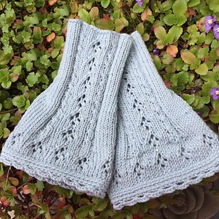 FREE PATTERN! These adorable fingerless mittens sport both cables and eyelets.