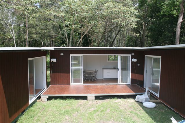 Shipping container homes with private courtyard... MY THOUGHTS>>> Put containers in a square. Add the self sustaining garden pool cover home in gillie suit type material. Fortify the exterior, add cycstern, bullet proof glass and more