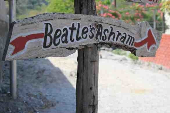 A locally made sign points the way to the abandoned complex Maharishi Mahesh Yogi Ashram – Rishikesh, India | Atlas Obscura