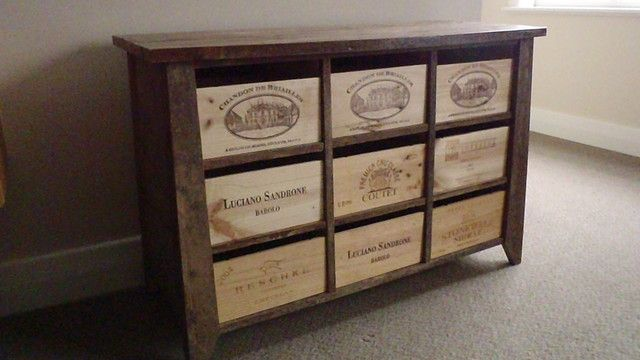 Wine boxes in a nice dresser style frame.