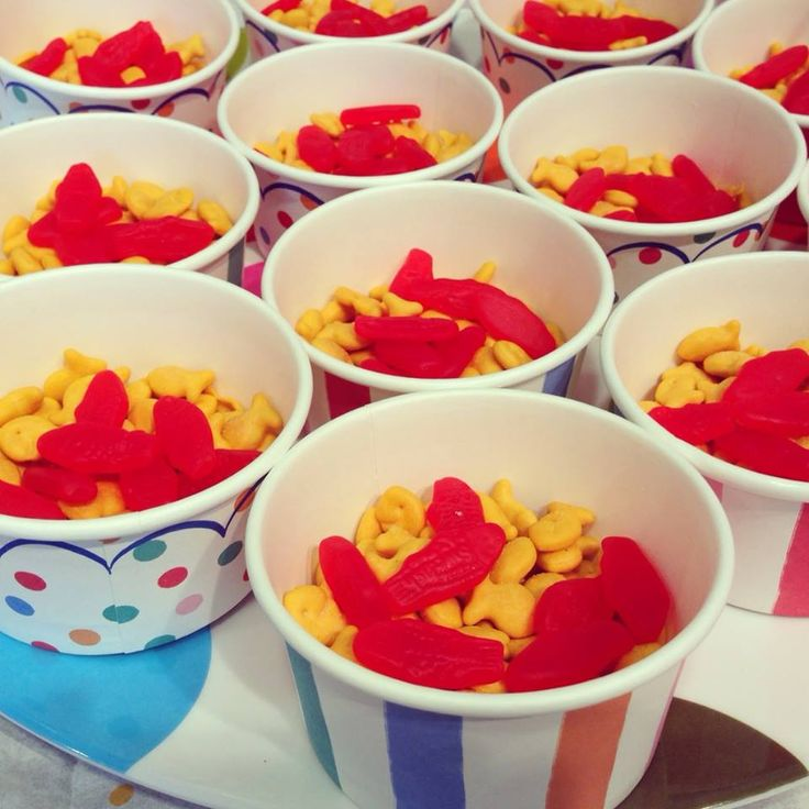 My daughter's cat-themed 8th birthday party.   Kitten chow (baby goldfish crackers mixed with baby Swedish fish).