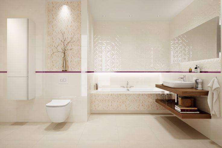 Płytki łazienkowe ze strukturalną powierzchnią, motyw liści na ścianie, beżowe kolory. Delikatny kolor w postaci listwy szklanej ożywi aranżację. Ravina - 25x75 cm - Opoczno