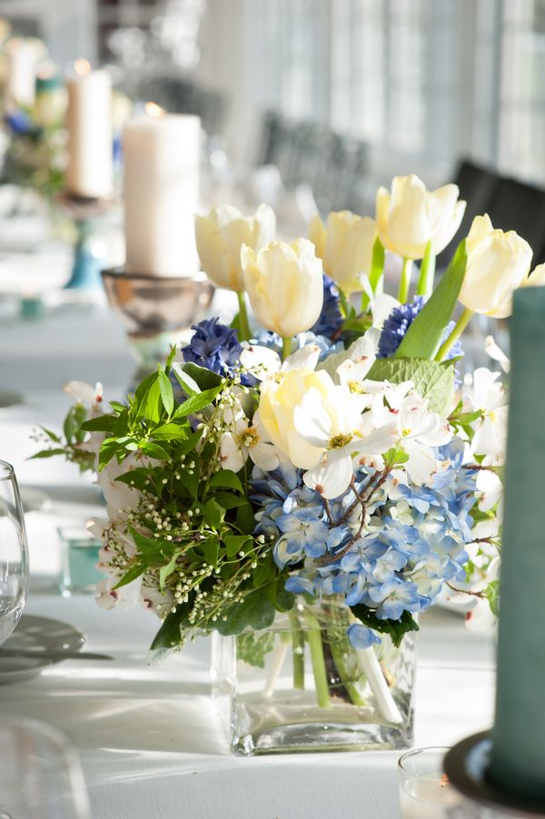 Blue hydrangea white tulip centerpiece glass vase