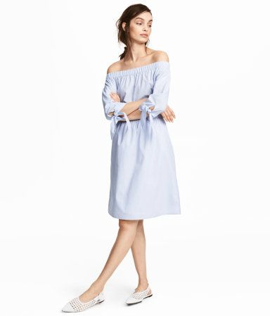 Light blue. Short, off-the-shoulder dress in a woven cotton blend. Wide elastication at top, 3/4-length sleeves with ties at cuffs, and elasticized seam at