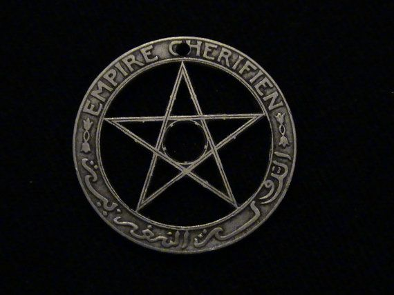 Christians and Satanists alike can enjoy this lovely pentagram, hand cut from a 1921 Moroccan, 1 franc coin.