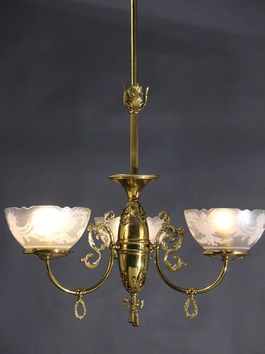 This chandelier and gas sconces were original equipment in an 1890 queen anne victorian that sold