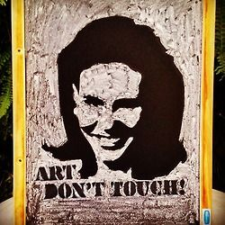 Narcisa Tamborindeguy says Art Don't Touch. Chalkboard art made by stencil.