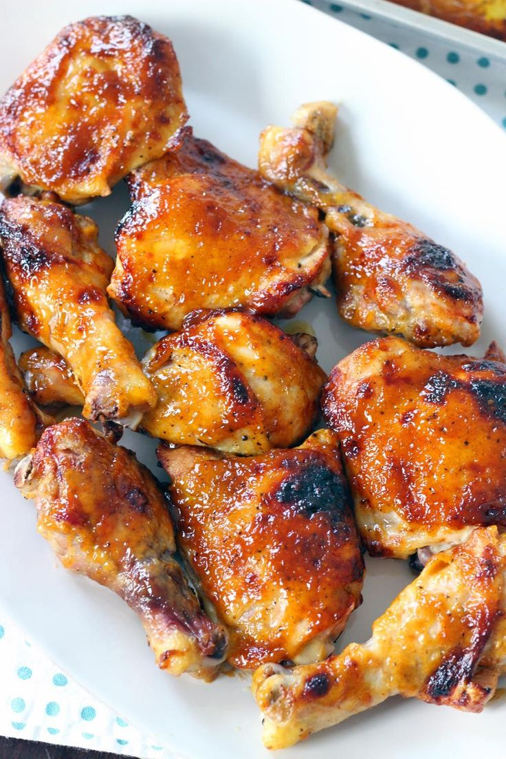 Two Ingredient Crispy Oven Baked BBQ Chicken | This recipe uses only TWO INGREDIENTS -  barbecue sauce and chicken (plus a little olive oil, salt, and pepper) - to make the crispiest, most perfectly glazed, sweet, sticky, and tender barbecue baked chicken you will ever have.