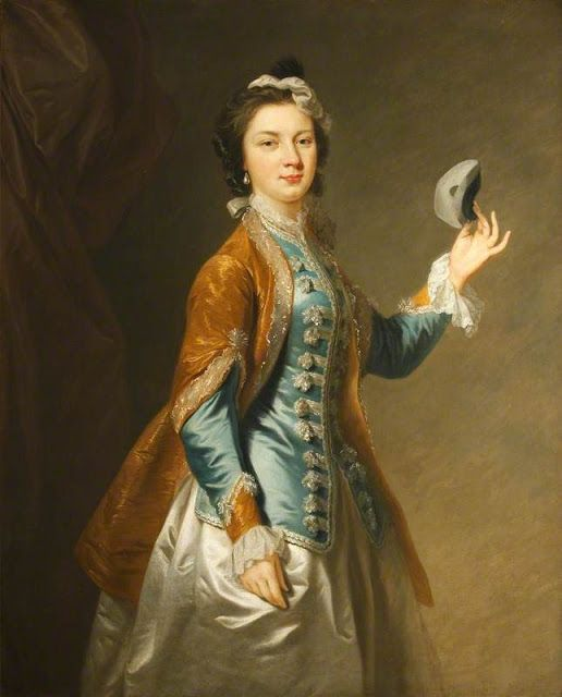 A young woman holding a mask by an artist of the British School