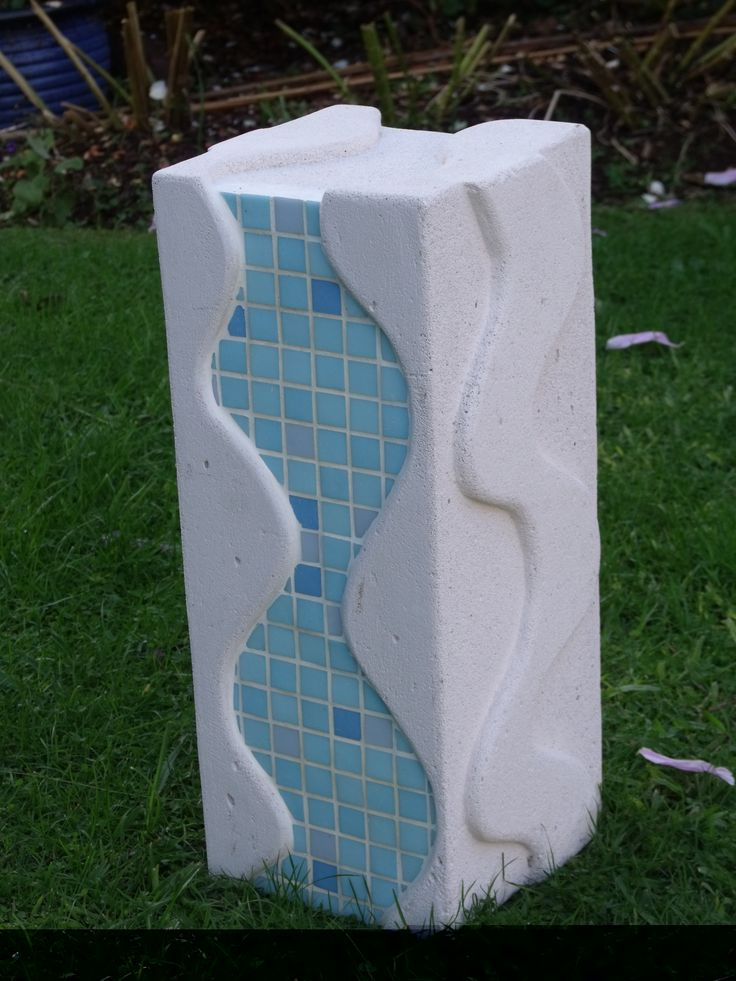 Combining my sculpture work and mosaics - may turn into a water feature some time - stands 450mm high by 200mm square. Made from Hebel aerated concrete block - so easy to work with and lots of fun to make :)