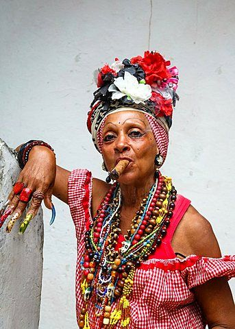 Woman smoking cigar, old Havana, Cuba.