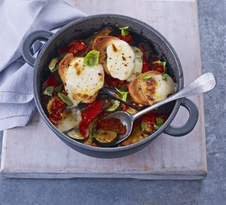 A vibrant dish for slow cookers, layer summery courgettes, tomatoes and aubergine with bread and mozzarella - irresistible!