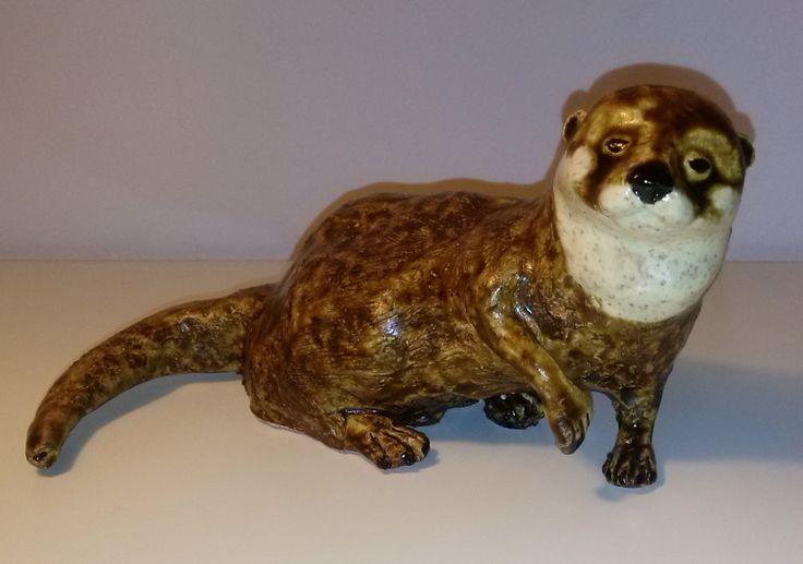 """Otter"".  Ca 10 cm hoog. Chamotteklei en glazuur.  In opdracht gemaakt."