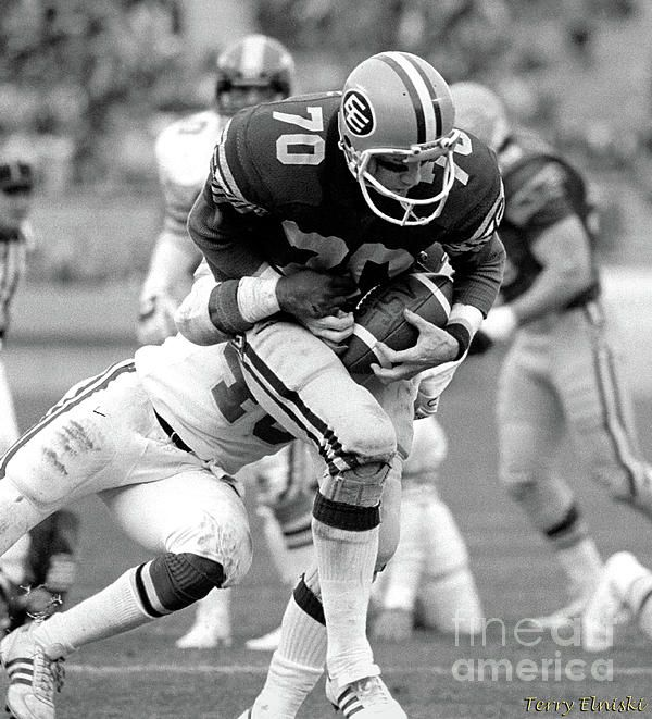 Edmonton Eskimos receiver Brian Kelly #70 catches a pass and makes it into the endzone for a touchdown against the Calgary Stampeders, 1983.