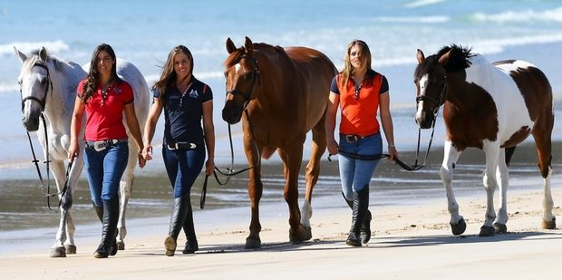 The Wilson sisters of Hukerenui are in a new television show detailing their work training wild Kaimanawa horses. From left: 25-year-old Kelly, 28-year-old Vicky, and 22-year-old Amanda.