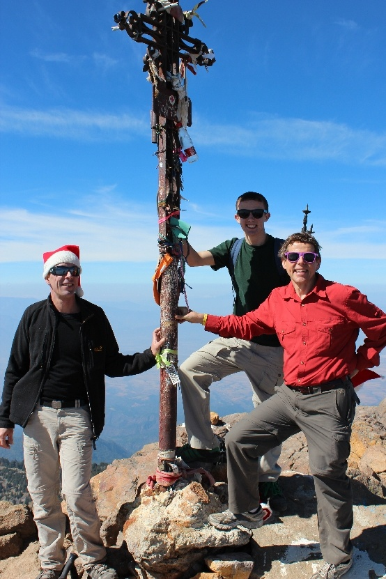 Nevado de Colima Volcano. This is the summit of the 14,000 foot mountain, marked by a sturdy iron cross. Michael on the left was our convivial Swiss companion on the climb, Tim is behind and I'm in the red shirt holding myself up after the exertion...