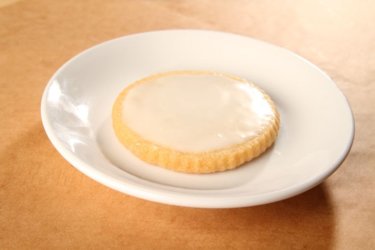 Tangy lemon icing and buttery shortbread make our Lemon Shortbread Cookies melt in your mouth. www.citybaking.com