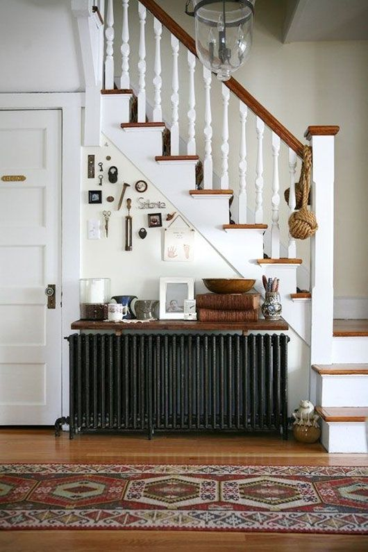 radiator love. / sfgirlbybay The radiator looks like bare metal. Would that work?  Or painted metallic  finish? THe wooden shelf over the rad looks good and also useful. Made from same wood as the new doors?