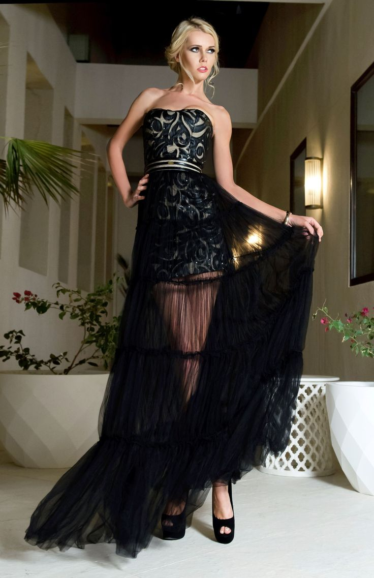 A short evening dress with sheer, long black skirt, following in the style of the Oscar 2015 after party style of Lady Victoria Hervey.