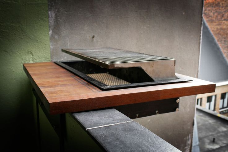 Barbecue that can hang off a balcony as a solution for small outdoor spaces. Designed by Mathias De Ferm.