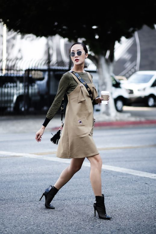 Neutrals for fall are huge (just as much as brights are this season, but we will get to that later) so you can imagine when we come across outfits like Chriselle's, were always elated. She perfectly layered a khaki colored dress over a striped sweater and added some killer heeled booties for the ultimate look.