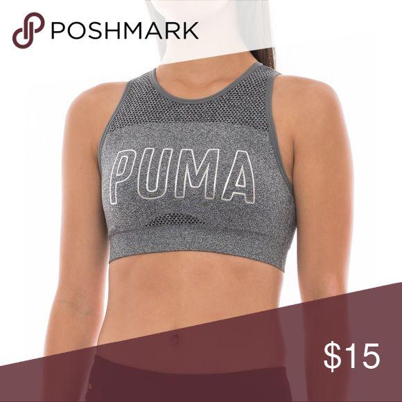 PUMA gray sports bra Light gray / metallic sports bra. amazing condition- only worn a few time.  Super cute/sexy criss cross back! Size small Puma Tops