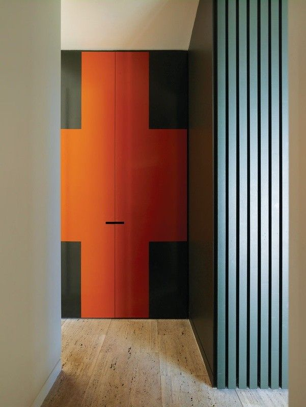 Not really a barn door, but love that bold color! - 70's graphic red cross on door of Hampton House II by Kennedy Nolan | Remodelista