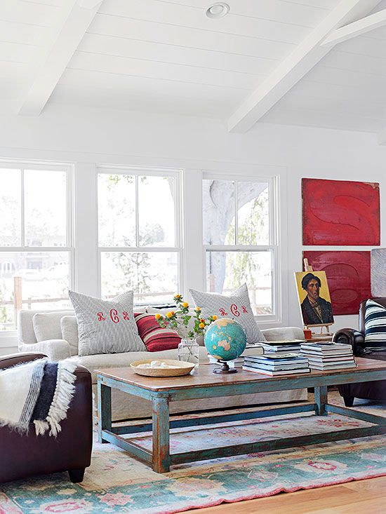 Secrets: Livable Style. I like the worn rug, distressed table with white walls and bright colors