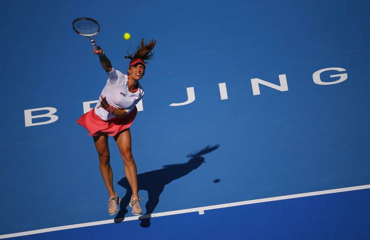Andrea Petkovic of Germany serves during her women's singles match against Simona Halep of Romania at the China Open tennis tournament in Beijing October 2, 2014. (REUTERS/Petar Kujundzic)