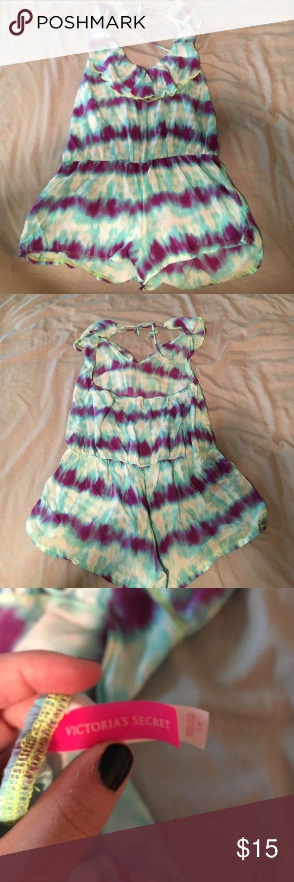 PINK cover up romper PINK swimsuit cover up romper. Purple white green and blue tie die romper with halter string tie. There's a cut out in the back that stops short of the bra line. Never loved this but you might! PINK Victoria's Secret Swim Coverups