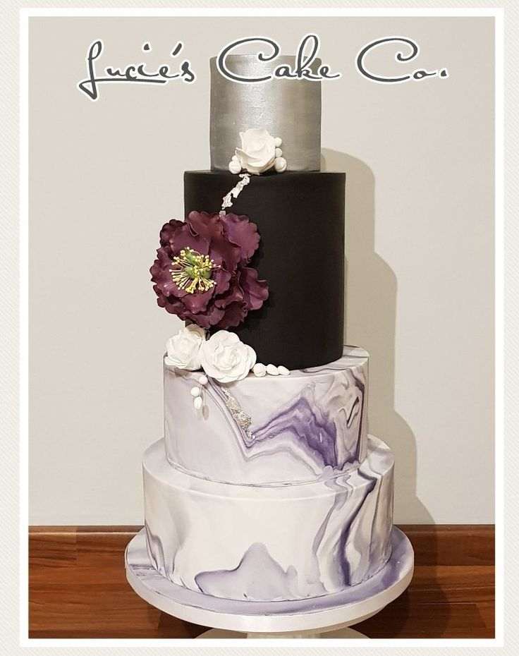 Ultra violet wedding cake. Pantone 2018 wedding colour of the year. Marble effect with black silver and large open peony.