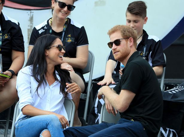 First picture of Prince Harry and Meghan Markle at official engagement as they hold hands at Invictus Games - Mirror Online