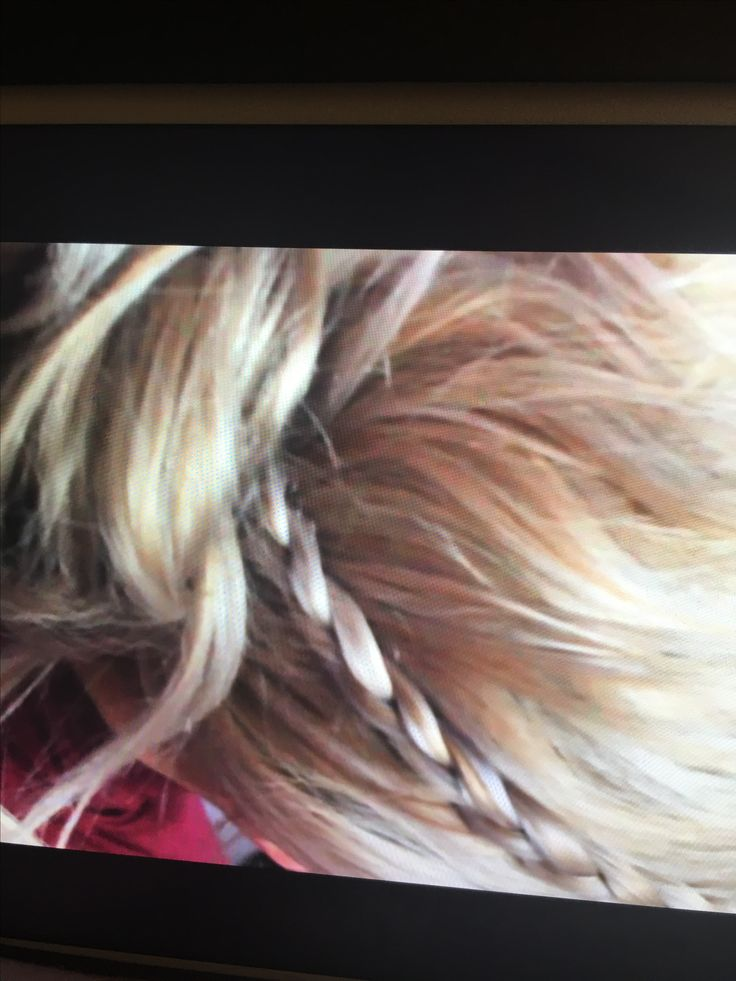 Dutch braid bun.  1) take front sections of each side of your hair and dutch brade going straight down until end. Tie off and leave it. 2) brush the r...