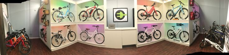 Go Time Electric Bikes new retail store design utilizing led lighting and custom cabinets to display Ebikes like art